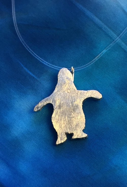 Penguin pendant from behind