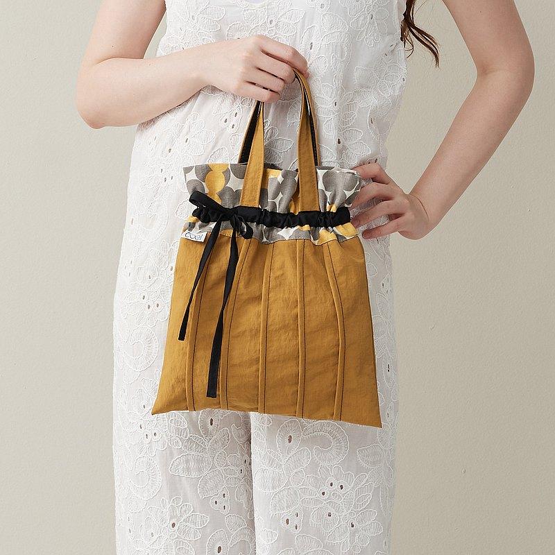 防潑水褶褶束口手提包 - 黃拼丸子串