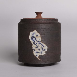 Black mud painted blue and white pot