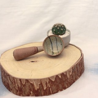 3.2.6. studio: Handmade ceramic tree bowl with wooden handle.