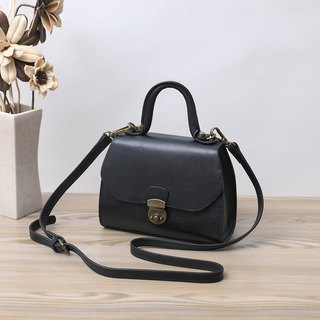 Vegan leather cow leather handbag
