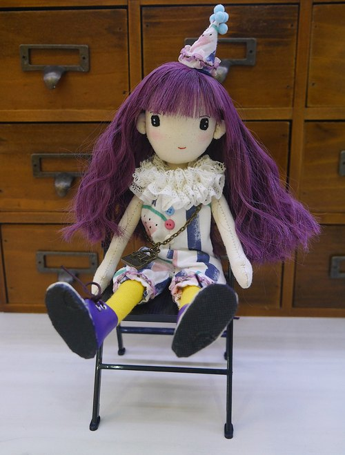 Handmade doll with cool purple hair