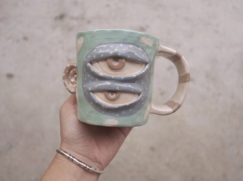 Handmade ceramic mug with 2 eyes in blue with blown ear :)
