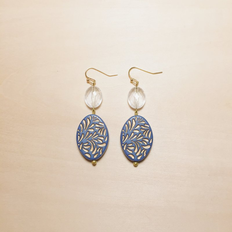Vintage sapphire blue carved oval earrings