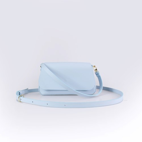 Zemoneni leather lady cross body shoulder bag and hand carry bag light blue color