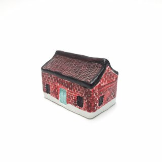 Hand painted red corrugated cement cottage
