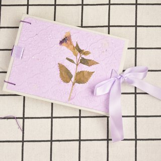 Handmade notebook with manual purple paper cover