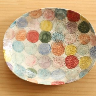 Oval dish of colorful dot dusting.