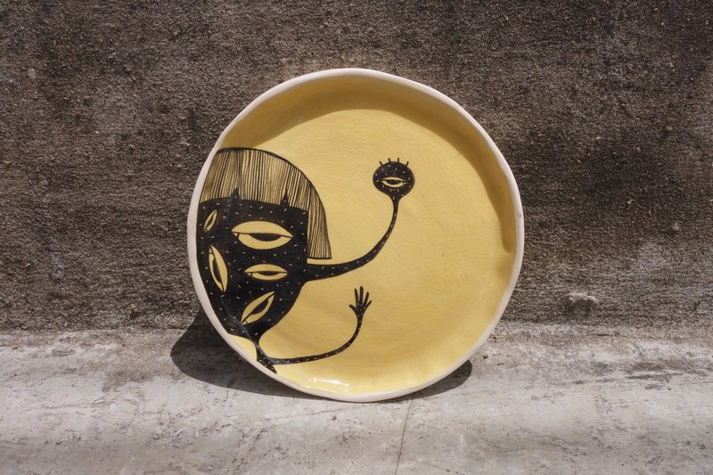 Ceramic plate yellow colour paint woman many eye :)