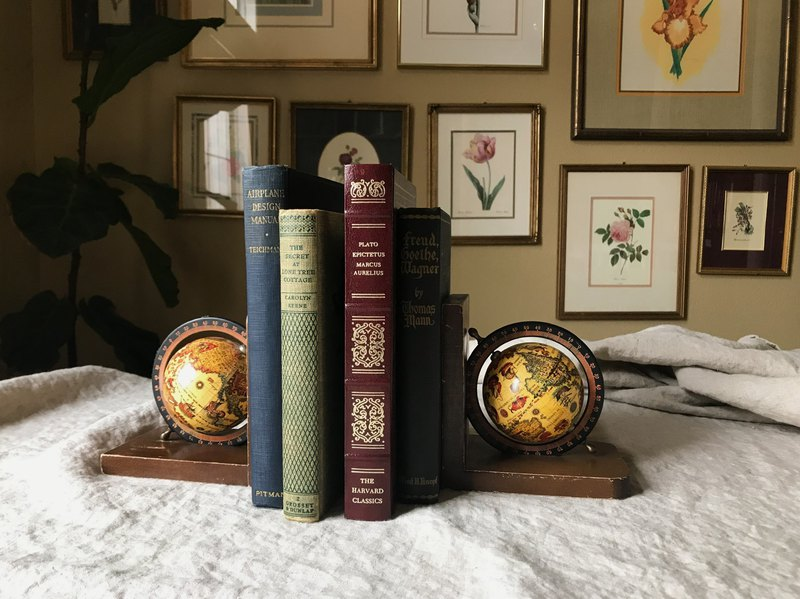 A pair of early globe styling bookends