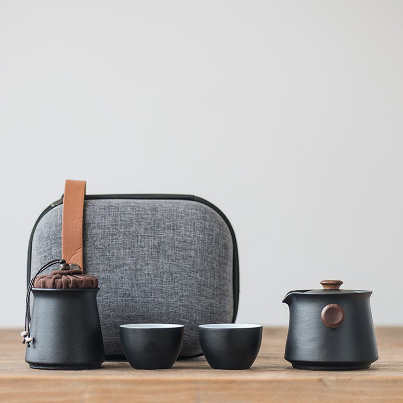 Wen said | Yin Chen black sand glaze stone pottery pot two cups fast passenger cup Japanese-style portable travel ceramic tea set
