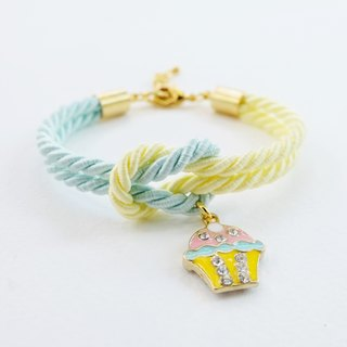 Light mint and light yellow knot bracelet with cupcake charm