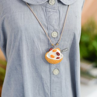 The coconut ice-cream with red and yellow beans handmade necklace from Niyome Clay.