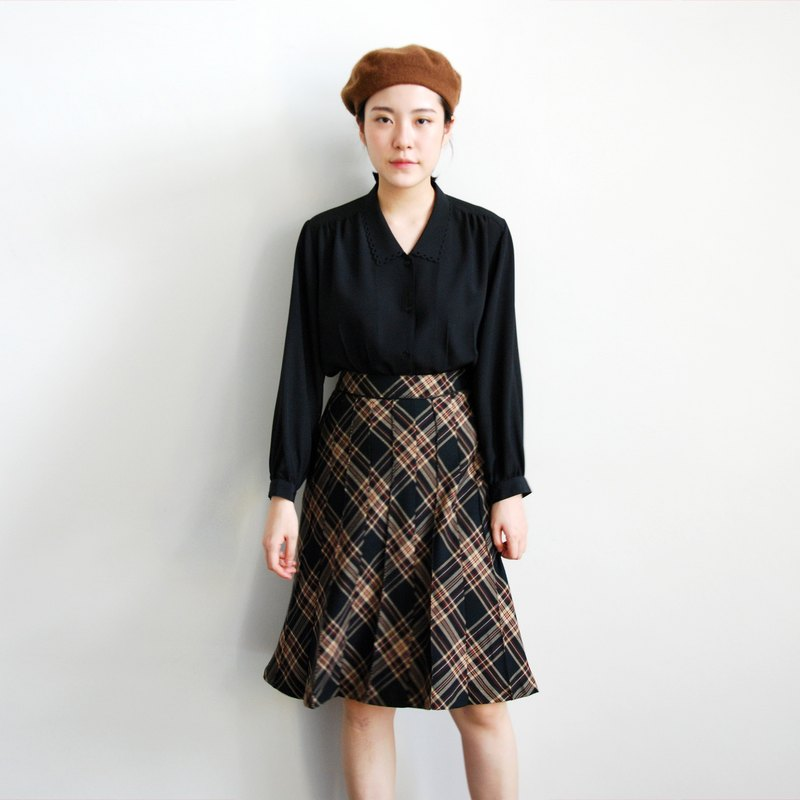 Pumpkin Vintage. Ancient checkered skirt