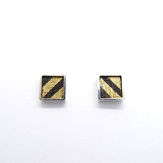 A centimeter square E-925 silver earring on the ear