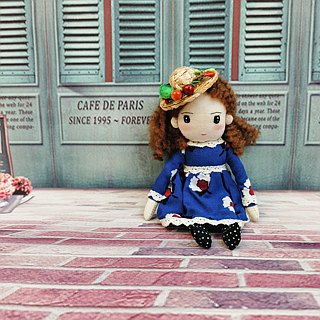 Handmade doll in curly hair