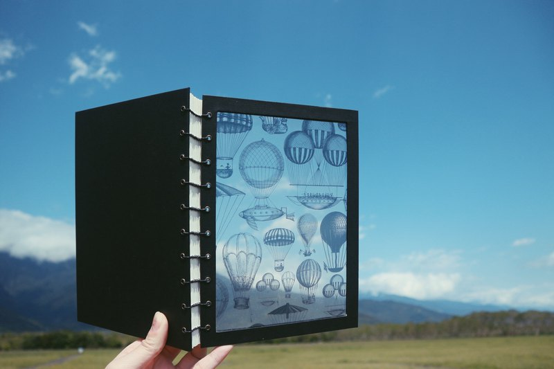 Transparent hot air balloon coptic handmade book