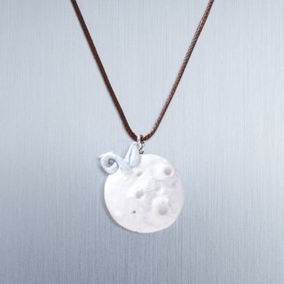 Active volcano with baobab trees. Two-hand white porcelain necklace