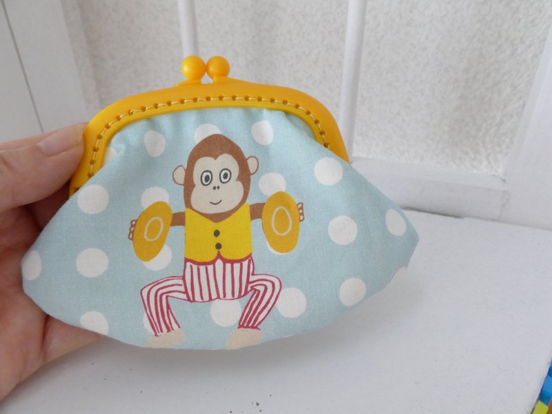Of cloth purse cymbal monkey