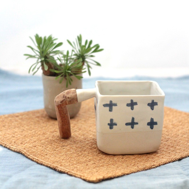 3.2.6. studio: Handmade ceramic coffee cup with wooden handle