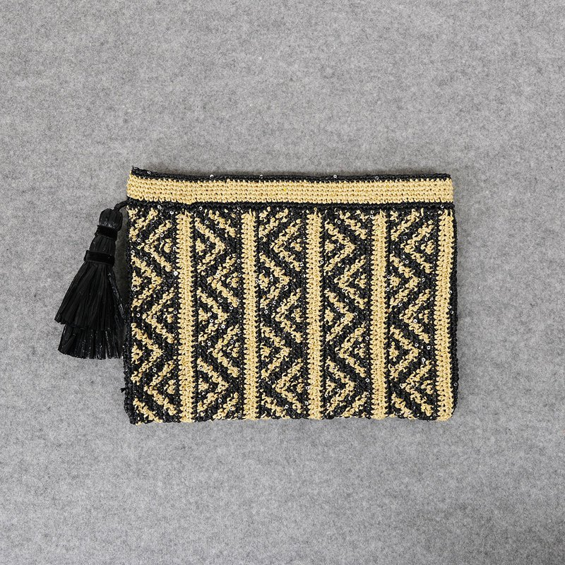 Hand knitted clutch bag