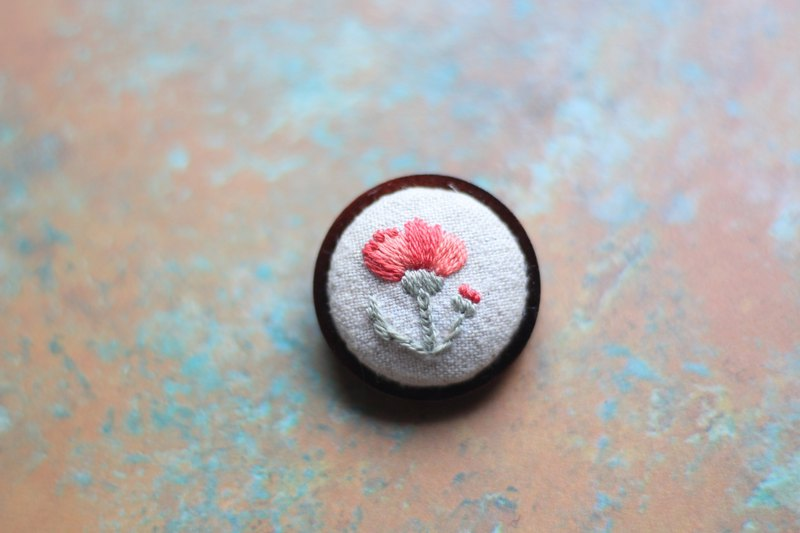 Hand embroidery pins. Red carnation