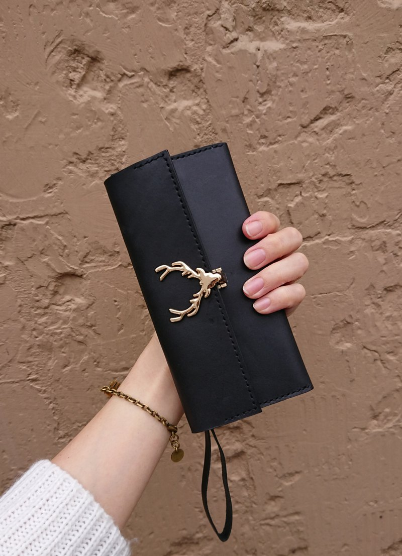 Leather hand sewing experience. Elk clutch bag. Can put mobile phone banknotes