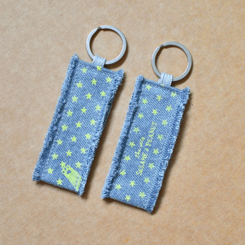 Cat hand stealing the stars hand-printed washed blue denim key ring (one into)