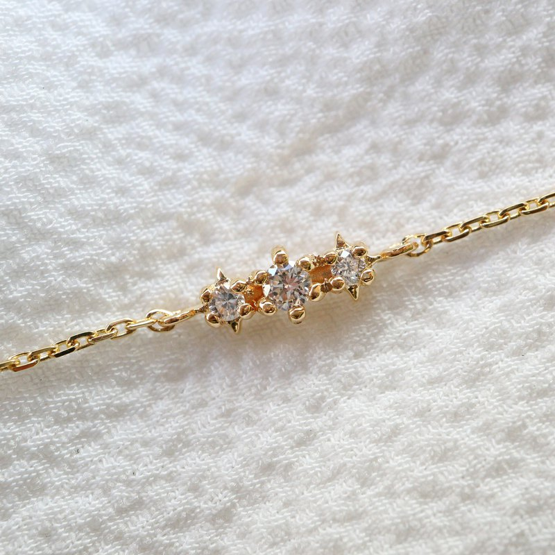 Three small diamond bracelets