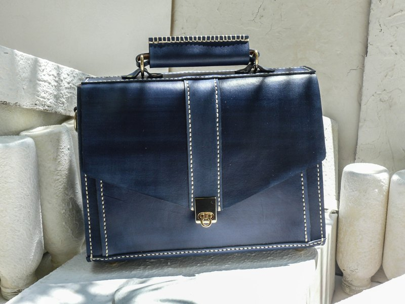 Not hit the bag blue vegetable tanned leather leather small briefcase