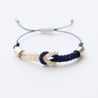Tiny tie the knot rope bracelet in Cream / Navy blue