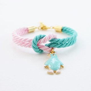 Matte Mint and pink knot bracelet with penguin charm