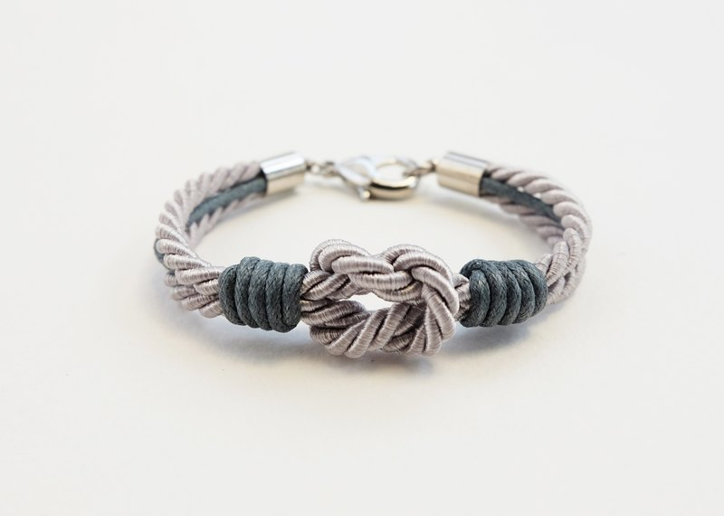 Light grey tie the knot bracelet with dark grey waxed cotton cord
