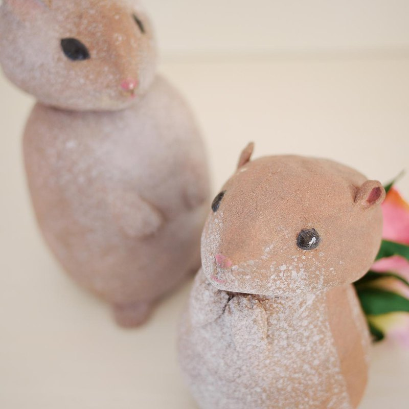 Goody Bag-Rabbit and squirrel carrying flowers
