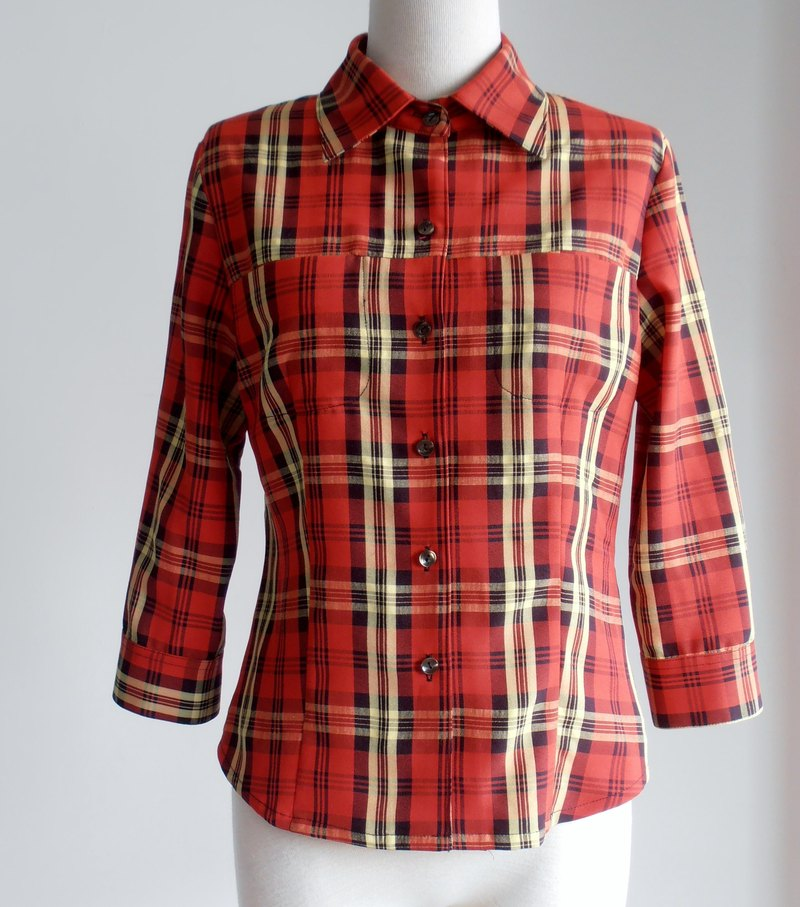 Red and yellow plaid shirt sleeve