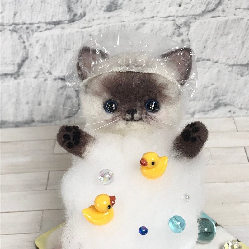 wool felt cat in a bubble bath.