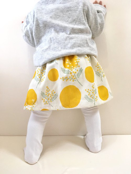 Mimosa pattern gathered skirt with baby mama and matching