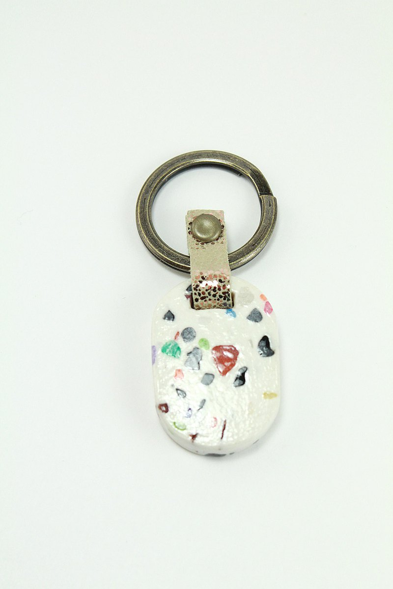 Oval white grindstone key ring pendant