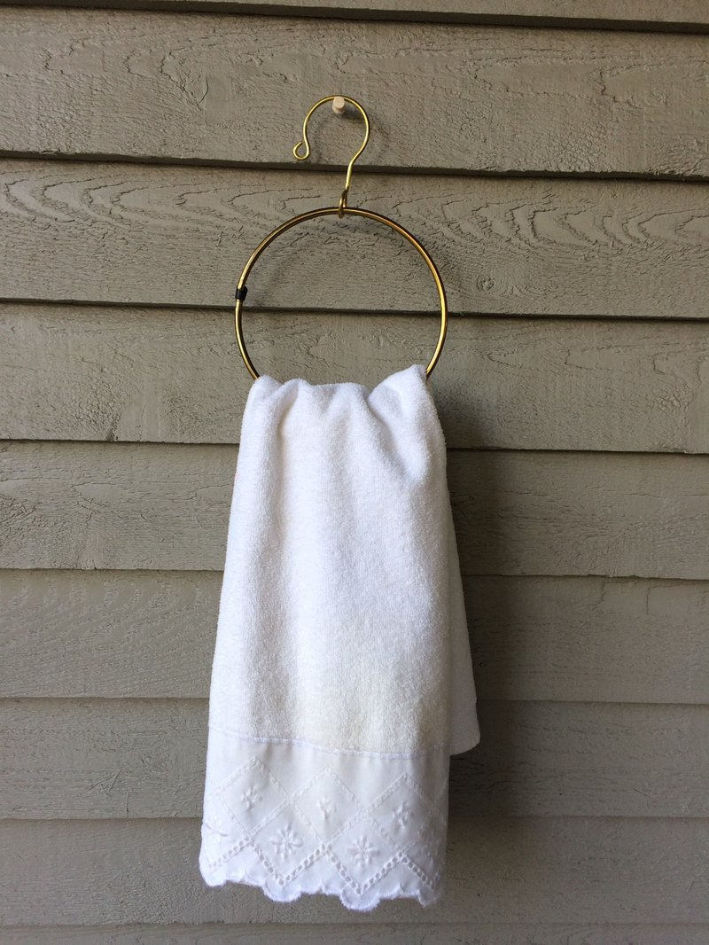 Gold ring towel rack