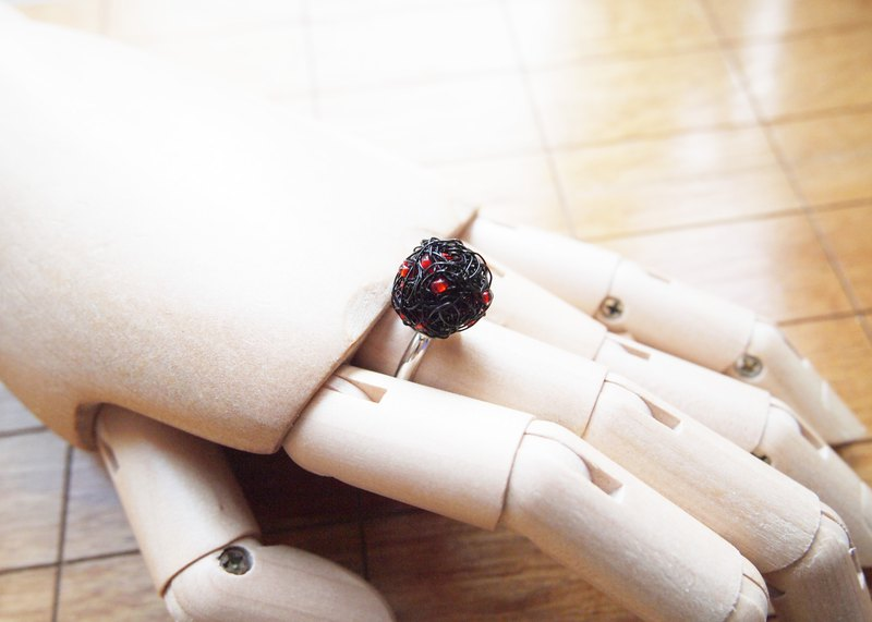 Hand-woven black elastic copper wire with orange red rubber beads ring