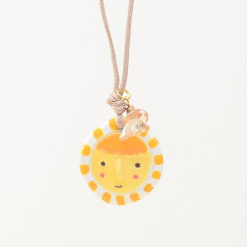 a little yellow chip boy handmade necklace from Niyome clay.