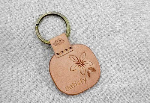 "- Symbol 『Puppy love』 "" as Tung Blossom . Key rings of leather carving with ❀ Florid ❀ by ♦ MonWorkshoP ♦"