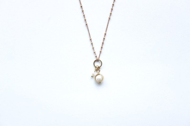 Brass necklace | Natural freshwater pearls | Geometry | Three-dimensional