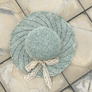 Rotating waves. Summer sunshade straw hat