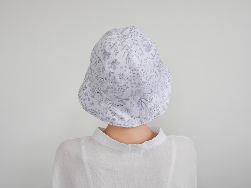 Dark blue floral hit double-faced fisherman hat on white