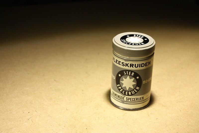 Originally purchased from the Netherlands in the late 20th century, the old gray cover beige tin can meat tin spice jar