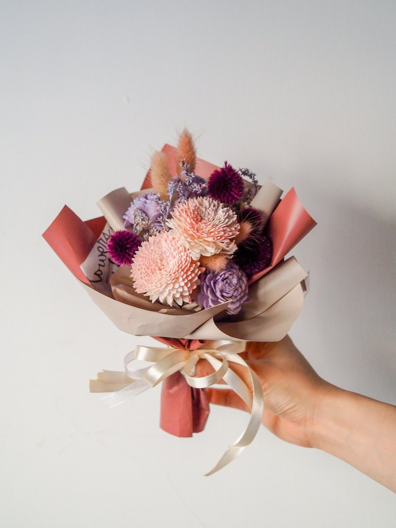 A small bouquet of pink and purple flowers. Dry flower