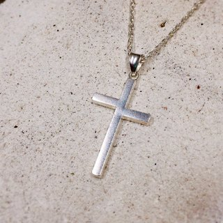 Asymmetric cross necklace