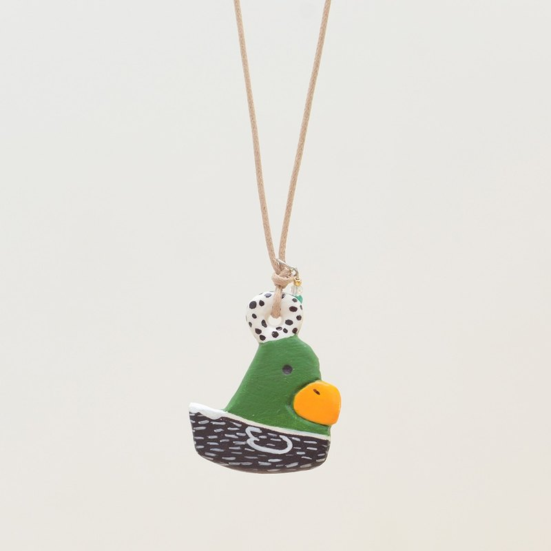 a little green duck handmade necklace from Niyome clay.
