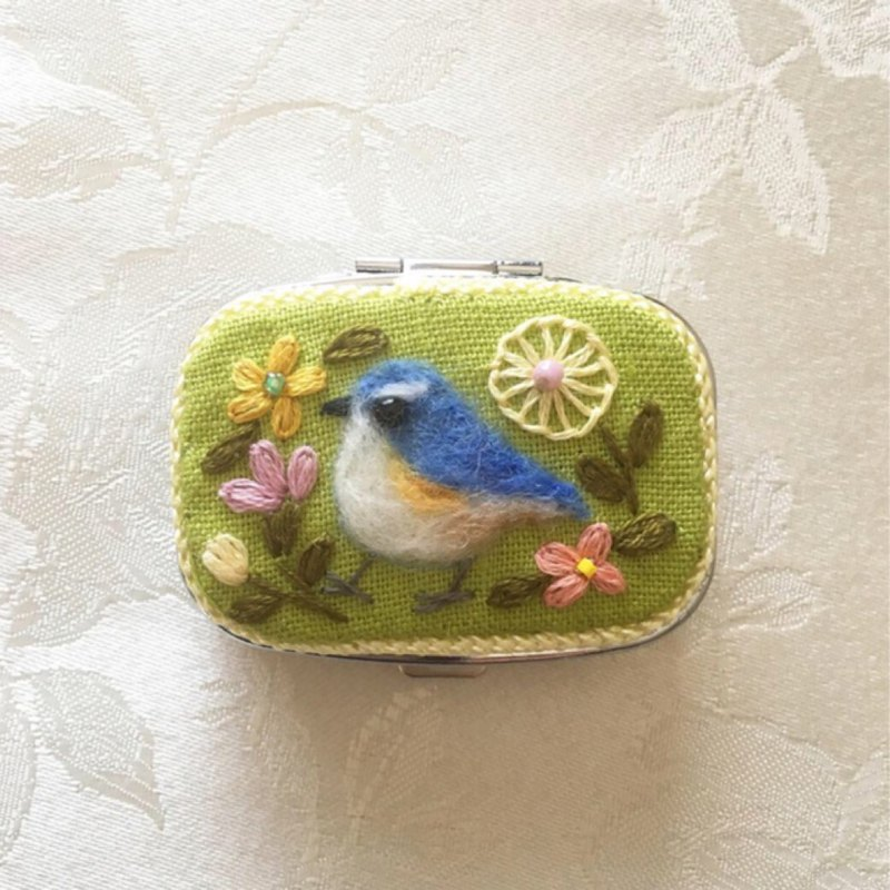 pill case of blue bird